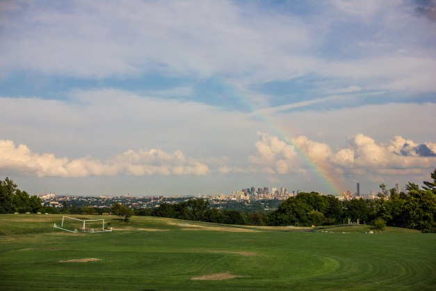 A rainbow appears over Boston as seen from Robbins Farm. July 29, 2013.