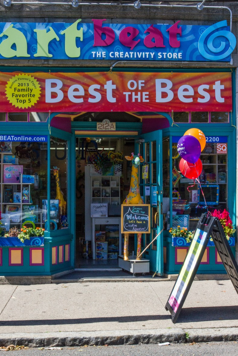 A large banner boasting of Art Beat's recognition as top five best toy stores in Massachusetts. August 14, 2013.