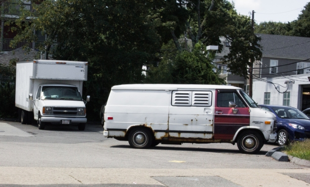 A old van with window louvers parked at a Massachusetts Avenue filling station. August 14, 2013.