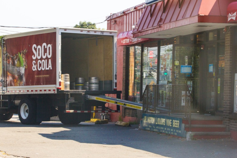 A vendor makes a delivery to a package store on Summer Street. August 28, 2013.