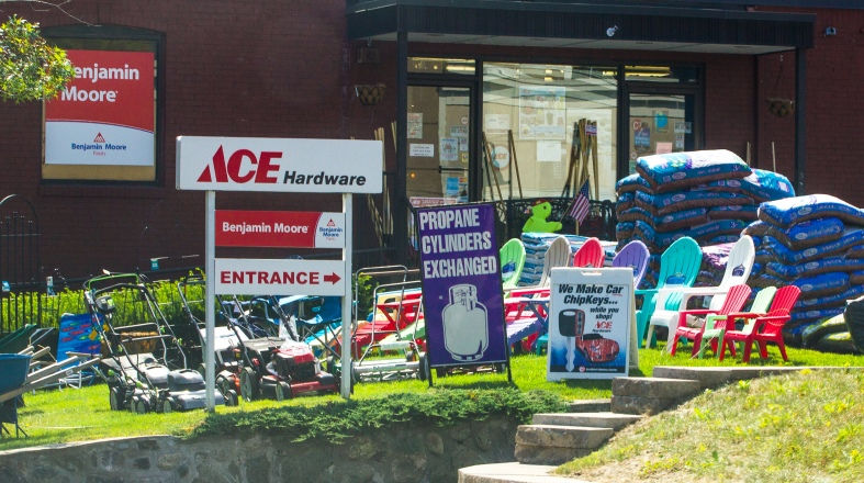 Products and advertisements cover the lawn of Ace Hardware on Mill Street. August 28, 2013.