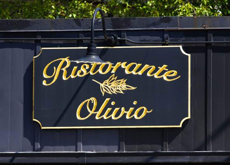 The gilded sign of Ristorante Olivio on Massachusetts Avenue in Capitol Square. August 28, 2013.