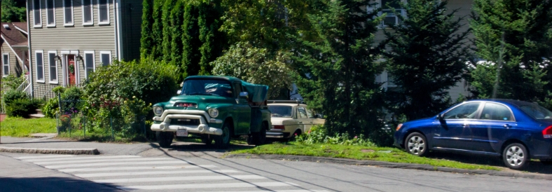A well maintained GMC pickup in the driveway of a Pine Street homE. August 14, 2013.