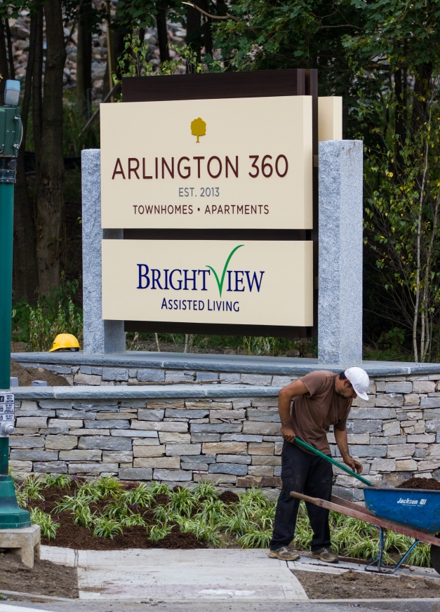 Work is done on the landscaping around the new sign at Hospital Road for Arlington 360 apartments and Brightview assisted living. September 12, 2013.