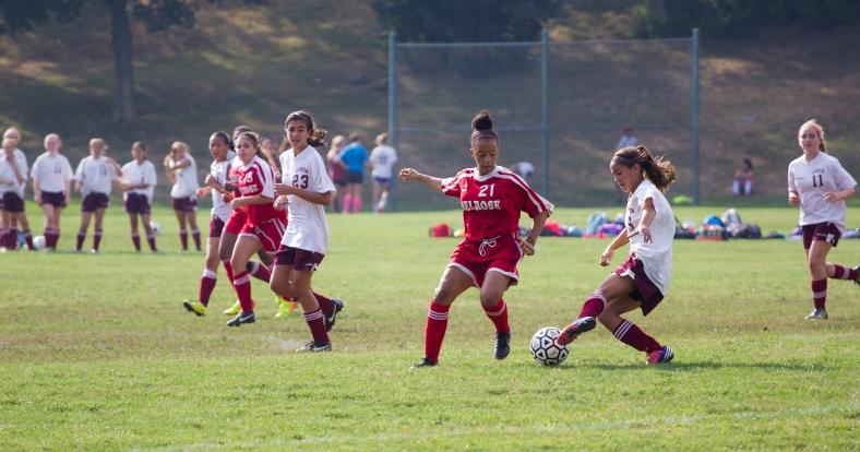 The Spy Ponder girls soccer team on the attack against Melrose during a game at Spy Pond field. September 12, 2013.