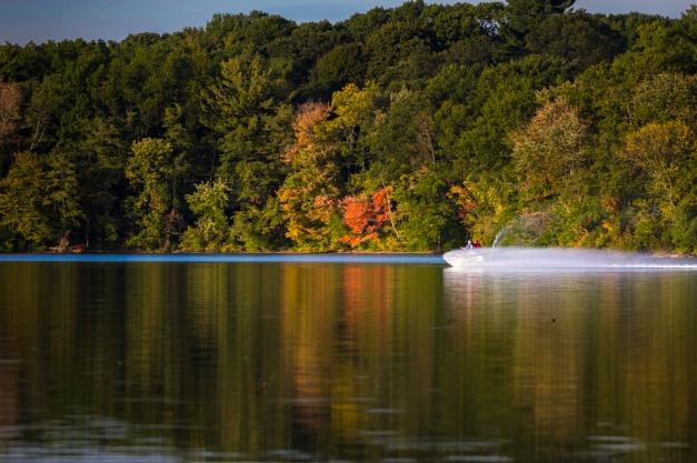 A jetski zips across the Lower Mystic Lake. October 3, 2013.