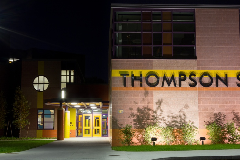 The lettering on the new Thompson Elementary School lit up at night. October 21, 2013.