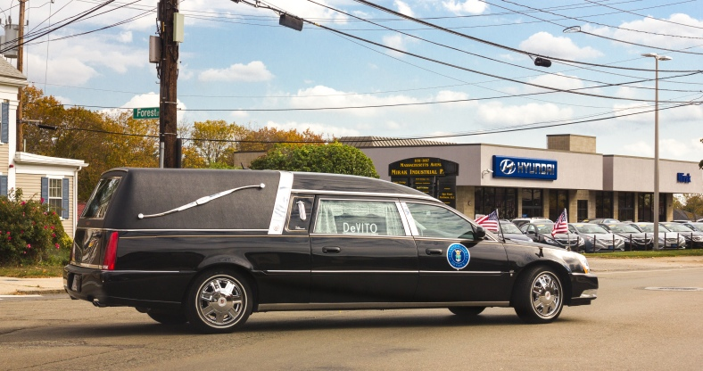 A hearse carrying a veteran of the United States Air Force turns onto Massachusetts Avenue on it's way to DeVito Funeral home. October 22, 2013.
