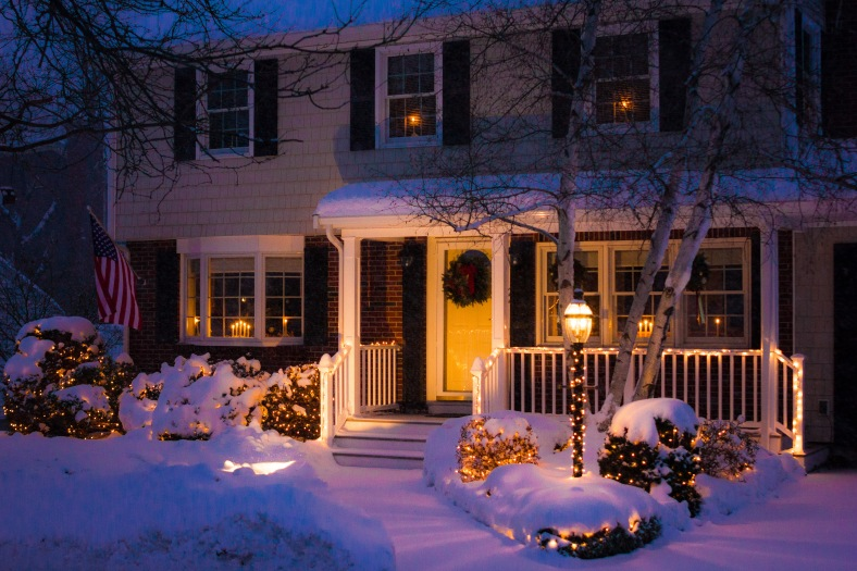 A warm and cozy looking house lit up for the holiday season during a snow storm passing through Arlington. December 17, 2013.
