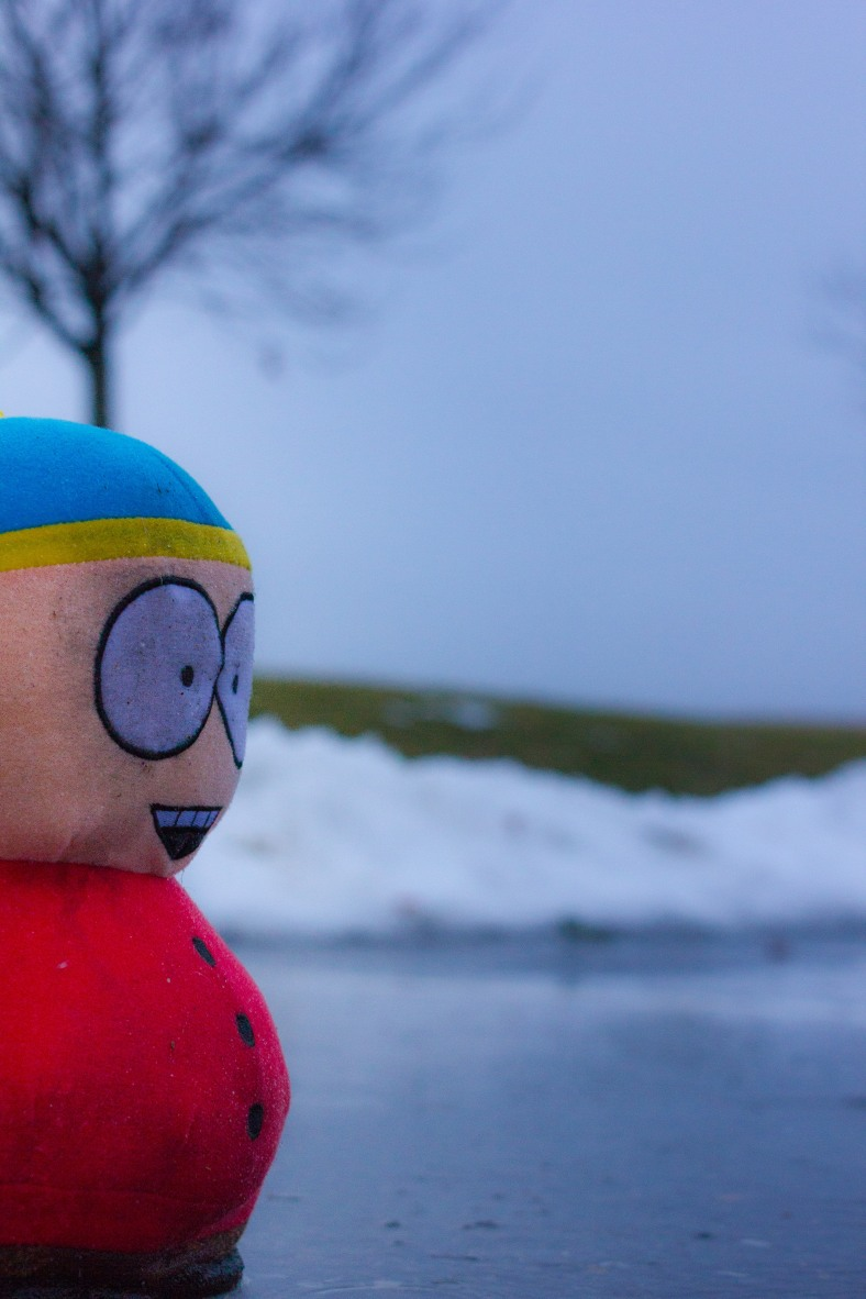 Eric Cartman endures the rain while standing in the middle of a parking space at McClennen Park. December 23, 2013.