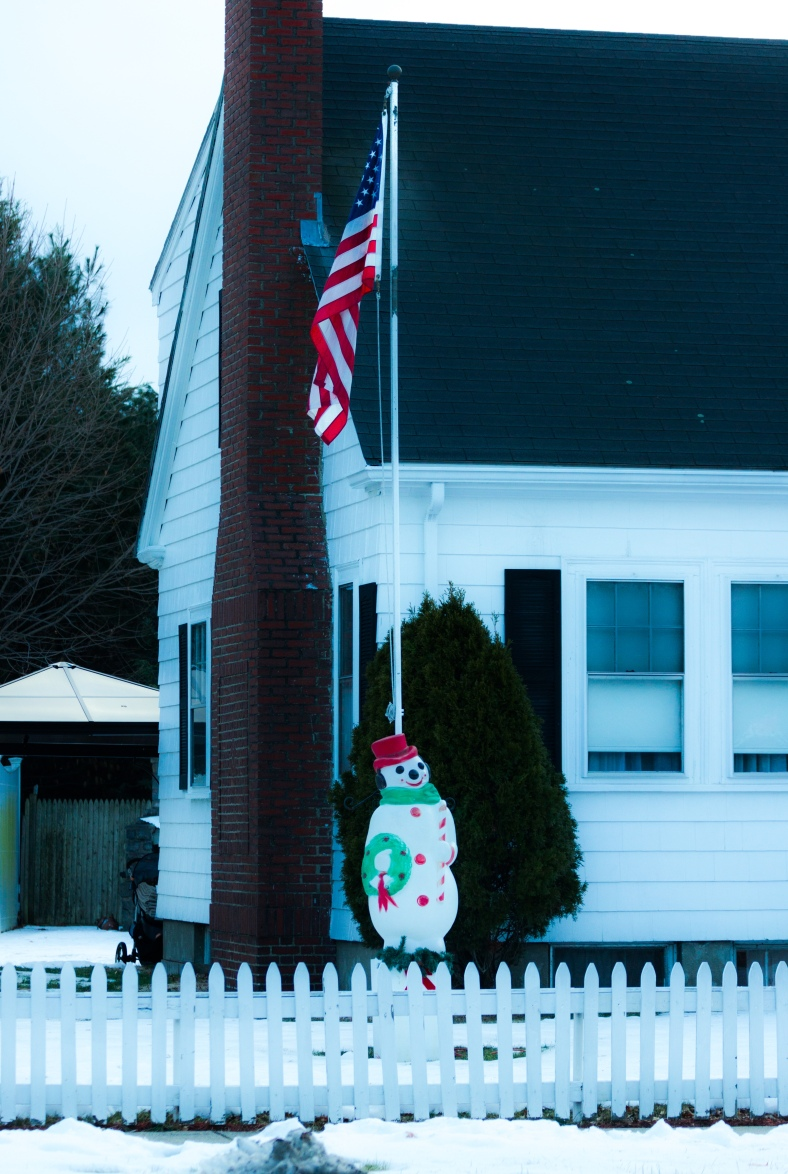A decorative snowman in the yard of a home along Mystic Valley Parkway. December 24, 2013.