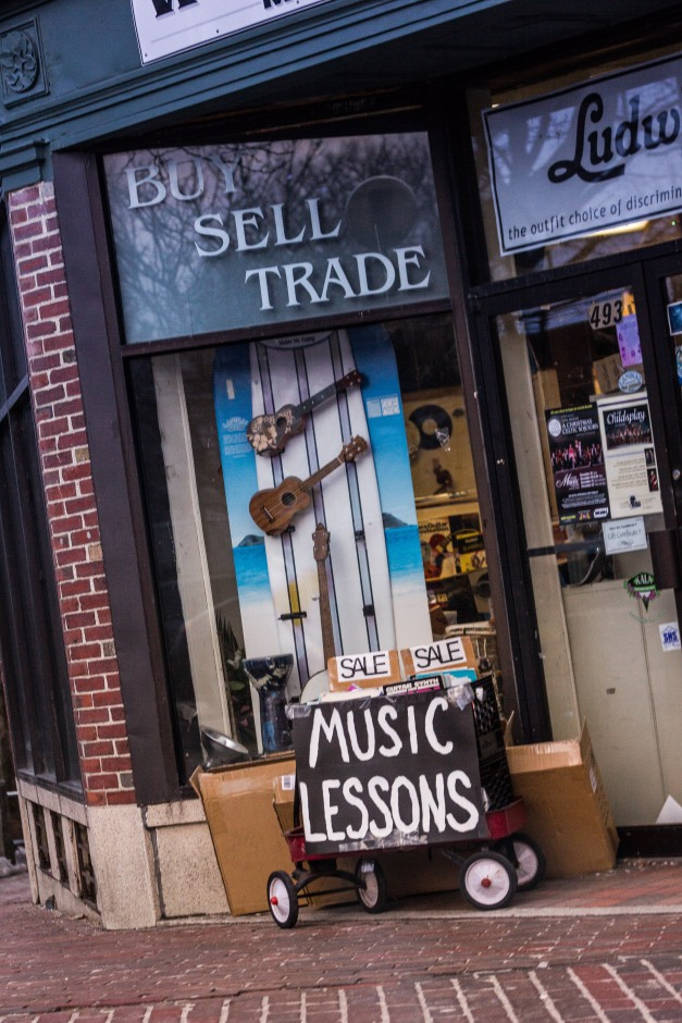 A sign outside Wood and Strings music store advertising music lessons. December 24, 2013.
