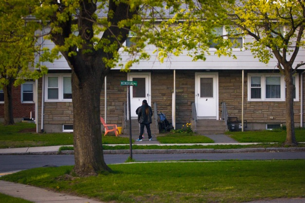 A man chats with a neighbor in the front yard of a Memorial Way home. April 28, 2013.