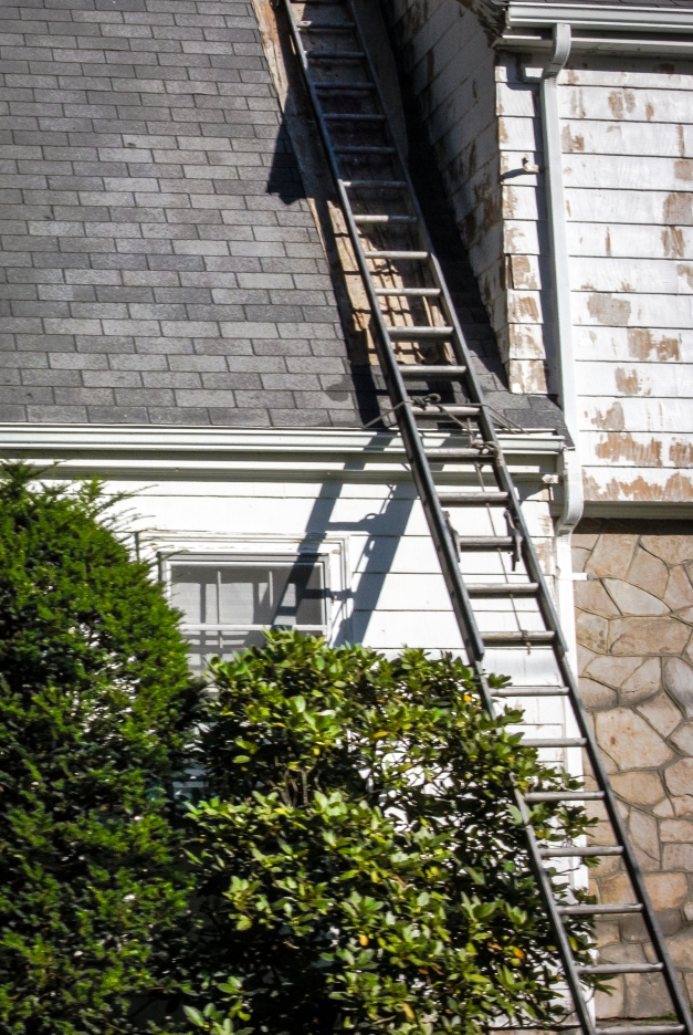 A ladder leans against a Grandview Road home in the midst of a paint job. July 29, 2013.