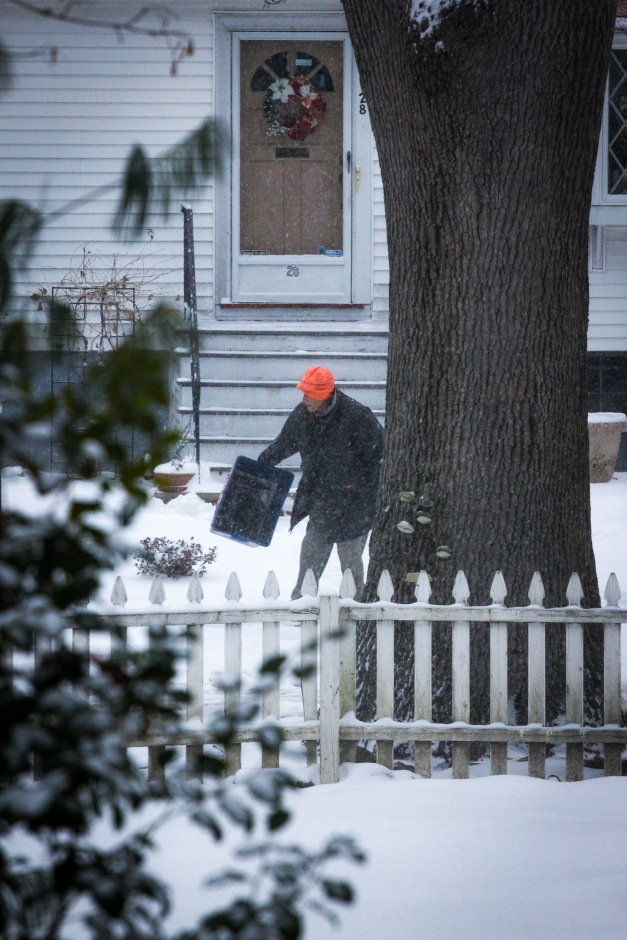 A Chatham Street resident takes in their recycling bin as regular collection was not postponed as a winter storm and sub freezing temperatures set in. January 2, 2014.