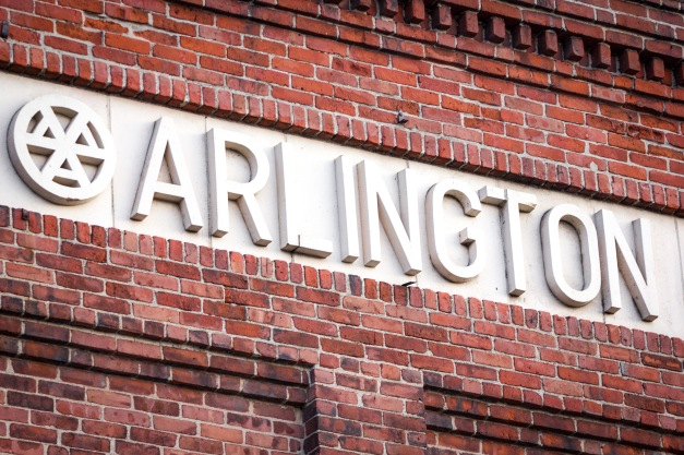 A detail of the sign for the Arlington Gas Light Company on Grove Street, which now houses Department of Public Works offices. January 13, 2014.