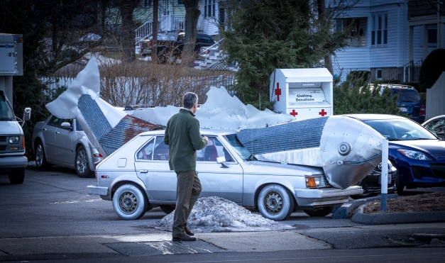 A man takes a closer look at a car-turned-fish sculpture at the Shell station on Massachusetts Avenue. January 13, 2014.