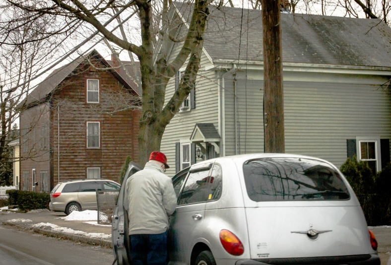 A man gets into his car along  Summer Street. January 31, 2014.