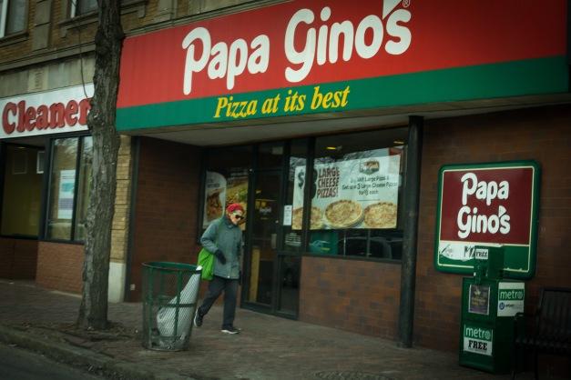 A woman walks by the Papa Gino's restaurant in Arlington center. January 31, 2014.