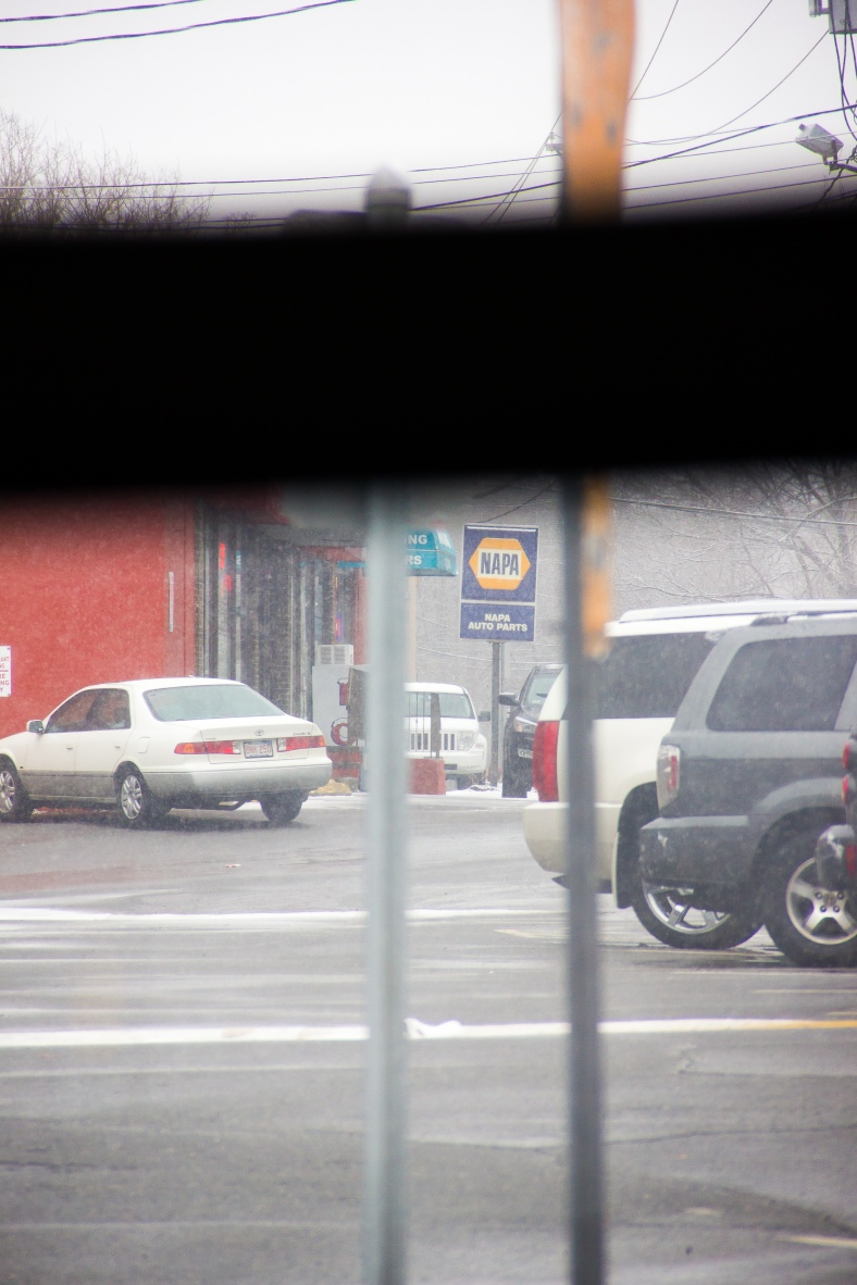 A view of Summer Street businesses from the route 67 bus. February 3, 2014.