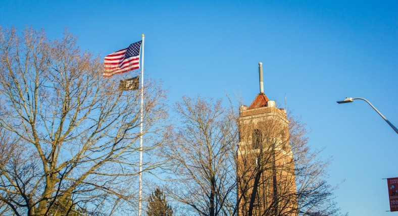 The flags at the Central Fire Station wave strongly in a steady February wind. February 22, 2014. SC