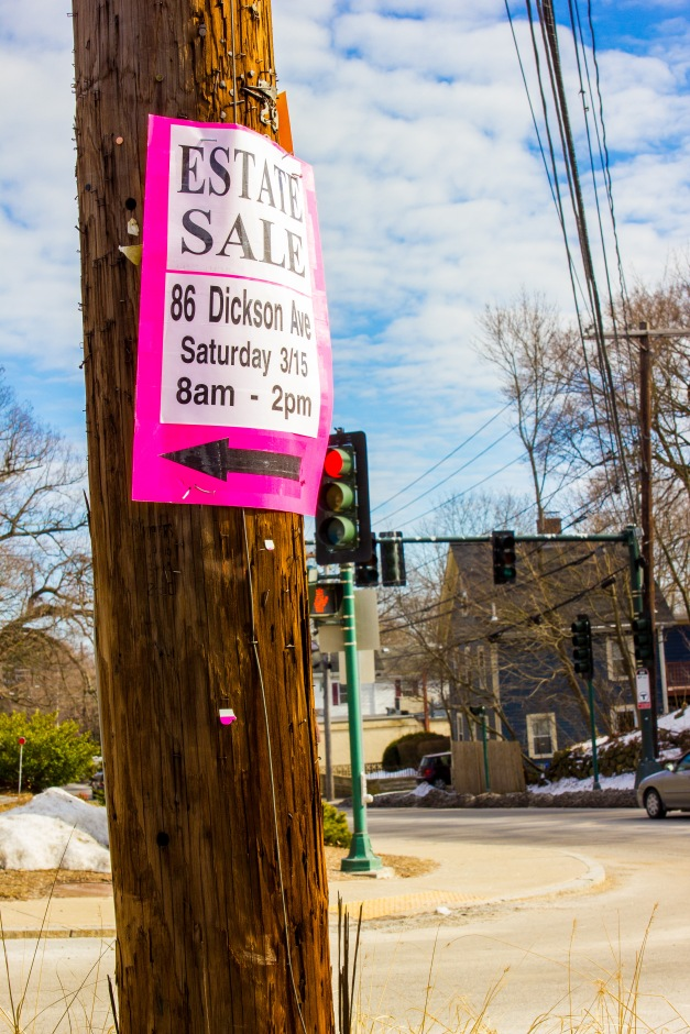 A sign advertising an estate sale posted on a telephone pole pointing up Hemlock Street. March 14, 2014.