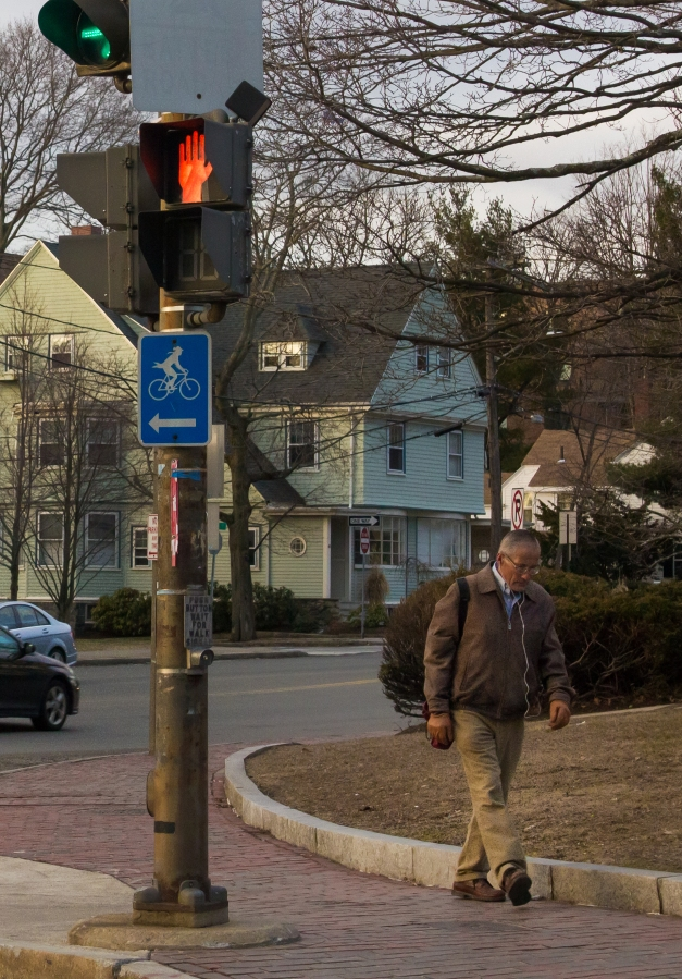 A man makes his way to the businesses or transportation on Massachusetts Avenue to start his day. March 21, 2014. SC