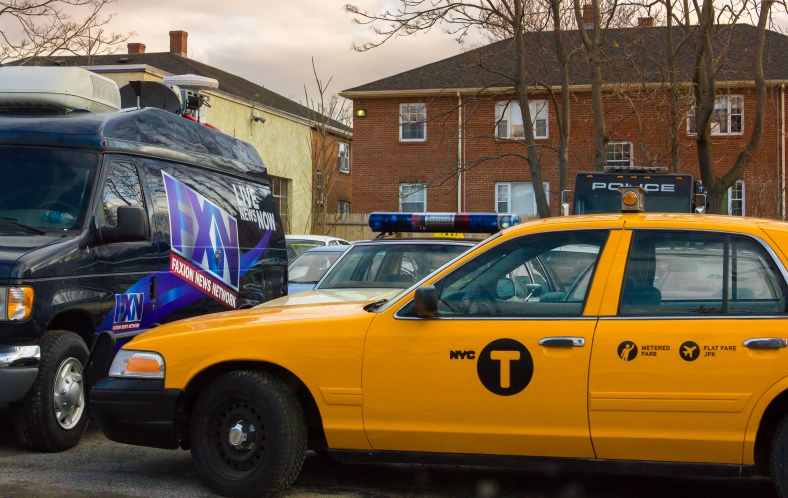 A New York taxi and a faux new van, no doubt prop vehicles for some upcoming motion picture or television show, sit in the lot at Anderson Automotive on Broadway. March 21, 2014.