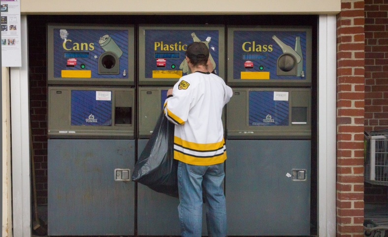 A man returns plastic bottles at the Stop and Shop. March 28, 2014