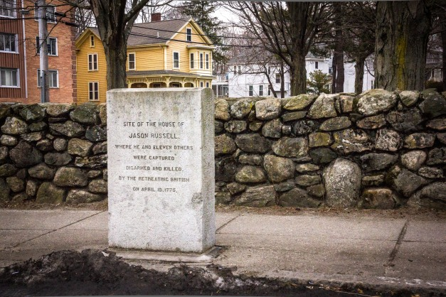 A stone tablet visible to passing motorists, perhaps retreating from Lexington themselves, summarizes the events that transpired during the opening moments of the revolutionary war at Jason Russell's house. May 28, 2014.