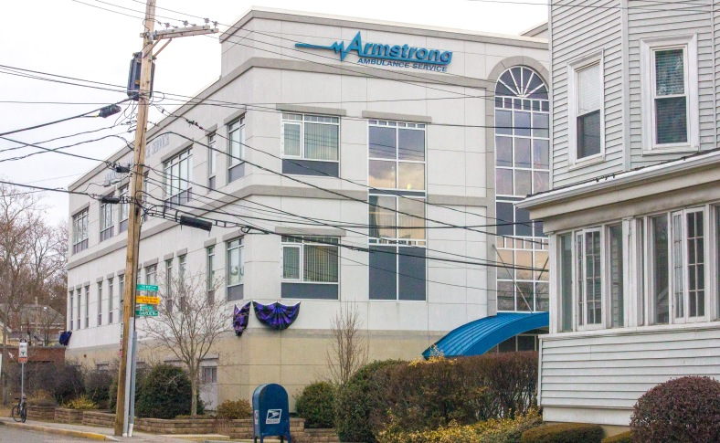 Mourning bunting displayed outside the Armstrong Ambulance Service headquarters on Mystic Street. The company's founder, William Armstrong, died earlier this month at the age of 89. March 28, 2014.