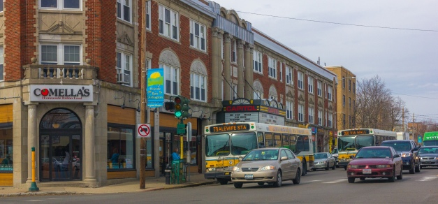 Busses from two different routes pull up in front of the Capitol Theatre. March 28, 2014.