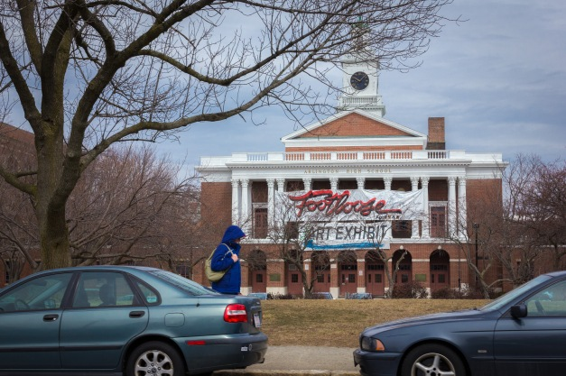 A banner on Arlington High School advertising its production of Footloose — and an art exhibit. March 28, 2014.