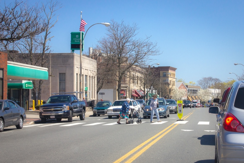 Two women make their way across Massachusetts Avenue in front of Town Hall. April 26, 2013.