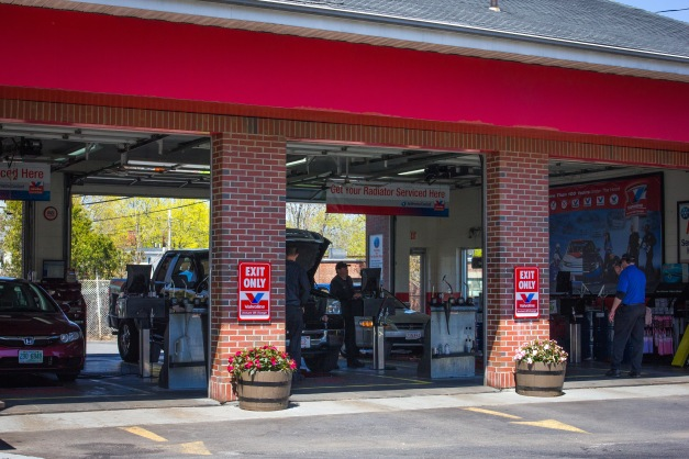 Cars being serviced at the Valvoline oil change garage on Mystic Street. April 26, 2013.
