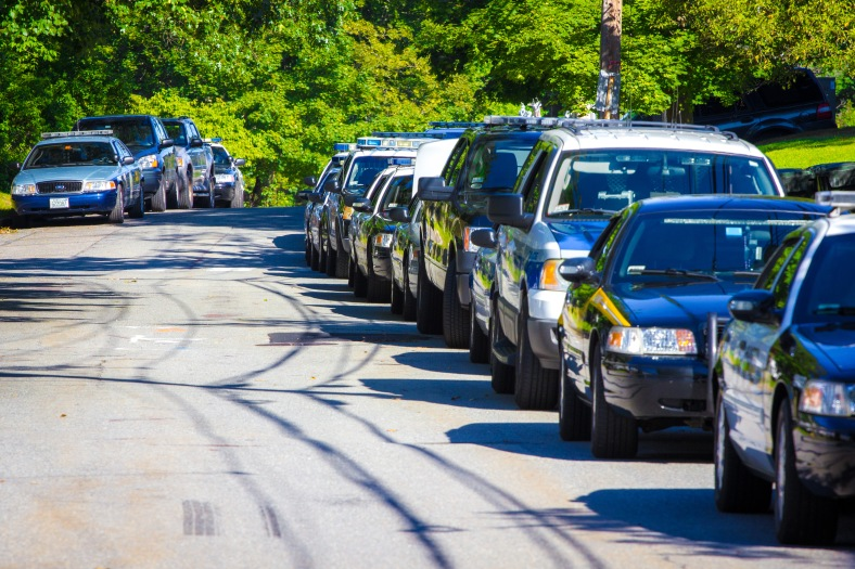 Police K9 unit cars from all over eastern Massachusetts parked along Pheasant Avenue during a day of training conducted at the Stratton Elementary School. July 30, 2013.