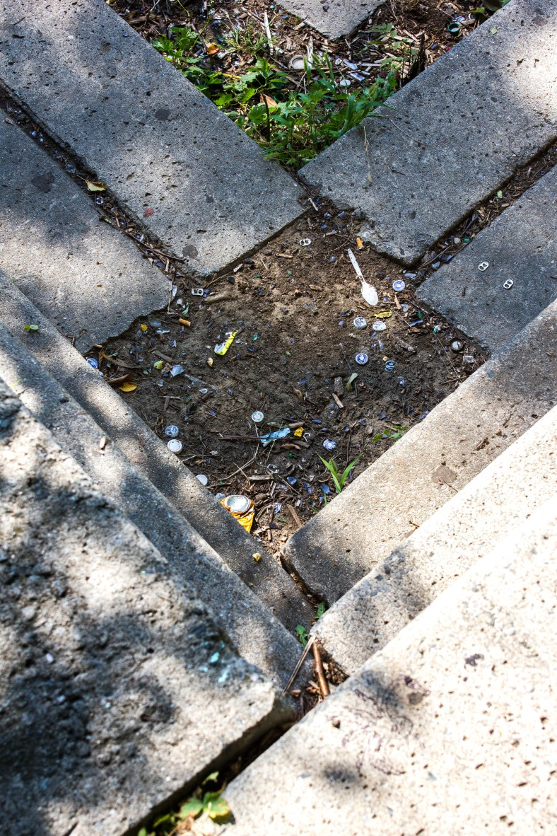 Litter on the concrete block retaining wall in the corner of Hill's Hill field. September 11, 2013.