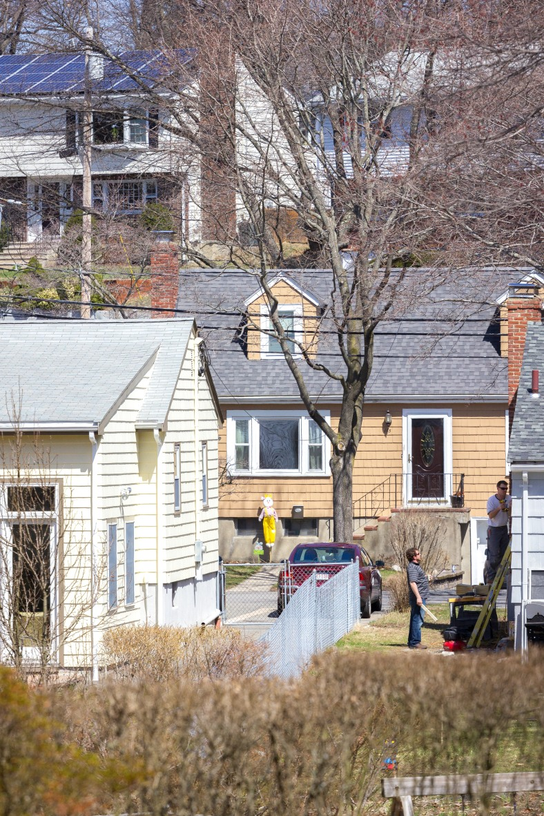 Two men chat while in the midst of a home improvement project. April 12, 2014.
