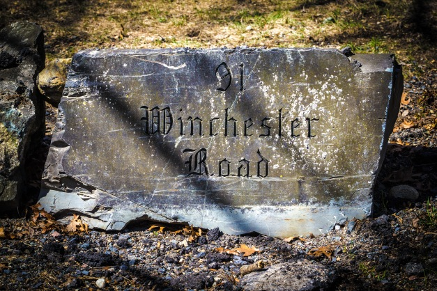 An address to a Winchester Road home carved into the rock on the property. April 12, 2014.