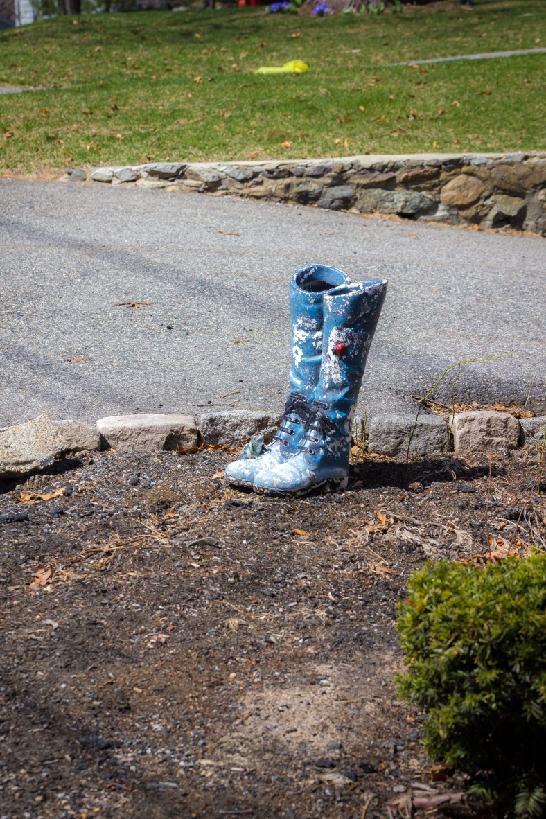 Decorative ceramic boots in the garden of a Winchester Road home. April 12, 2014.
