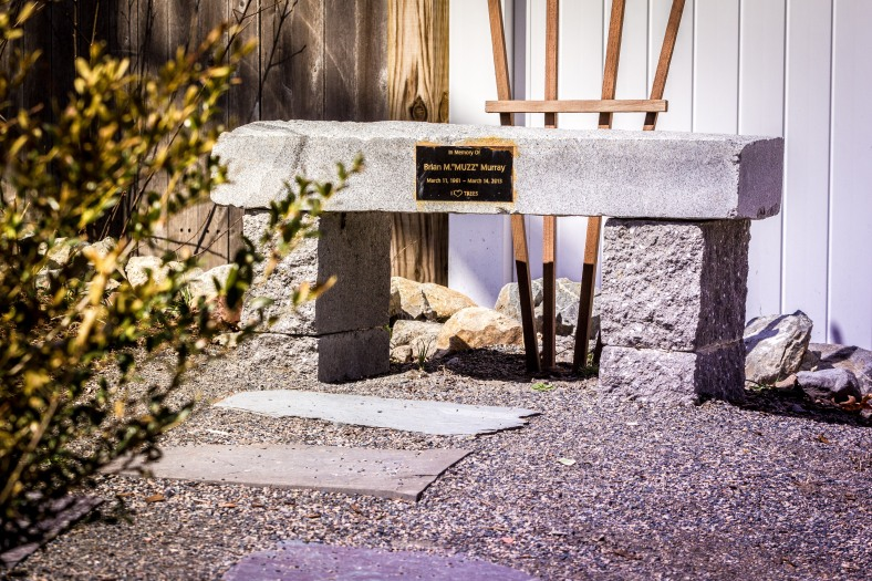 "A small bench in a small landscaped area next to a small speed bump on Morningside Drive dedicated to Brian ""Muzz"" Murray. April 12, 2014."
