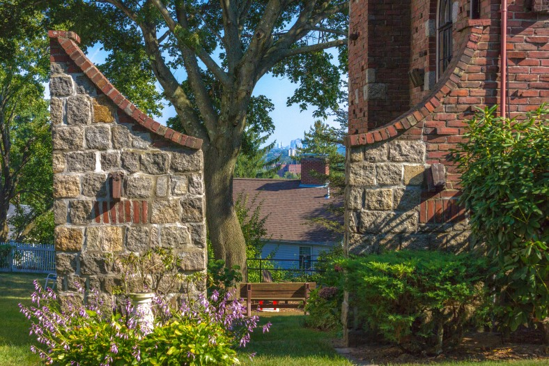 A gate leading into the backyard of a DLF Street home and onto views of Boston. September 11, 2013,