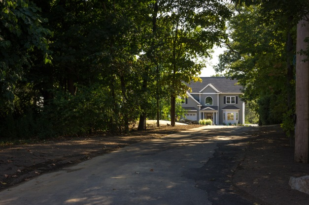 A newly contracted home at the end of a long, shady driveway off of Millett Street. September 11, 2013.