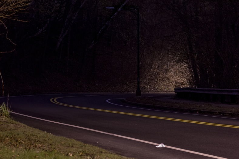 Streetlights illuminate spots along Mystic Valley Parkway as it ribbons around the Lower Mystic Lake. May 2, 2014.