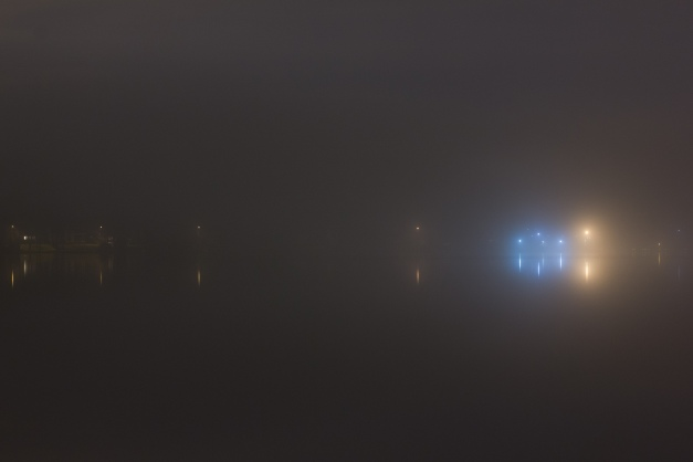 Lights on the strip that separates the Upper from the Lower Mystic Lake as seen through the mist on a May night. May 2, 2014.