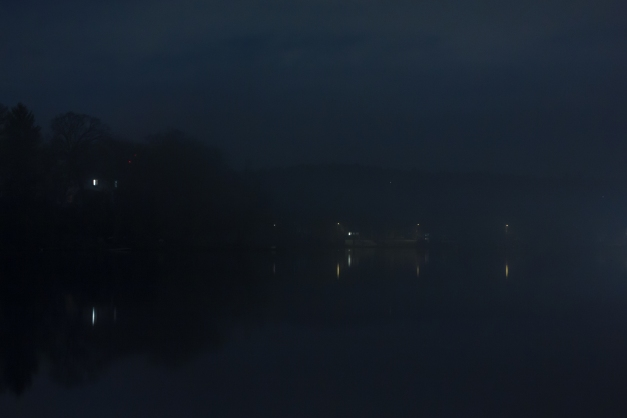 Lights from Arlington homes can be seen across the Lower Mystic Lake on a Spring night. May 2, 2014.