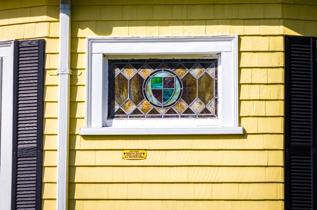 A stained glass window displayed in the side of a Rockland Avenue home. May 12, 2014.