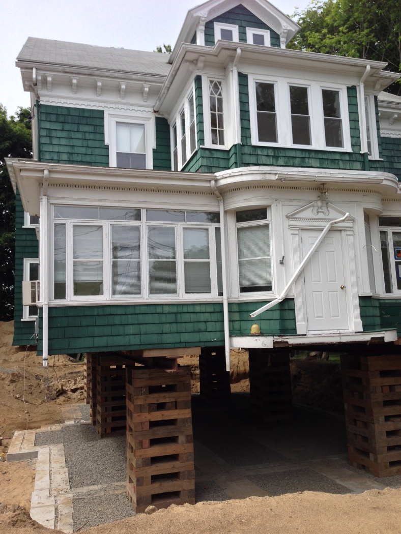 A house on Lake Street lifted for foundation replacement. June 11, 2014.