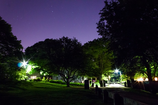 Jason Street illuminated at night as seen from Menotomy Rocks Park. June 1, 2014.