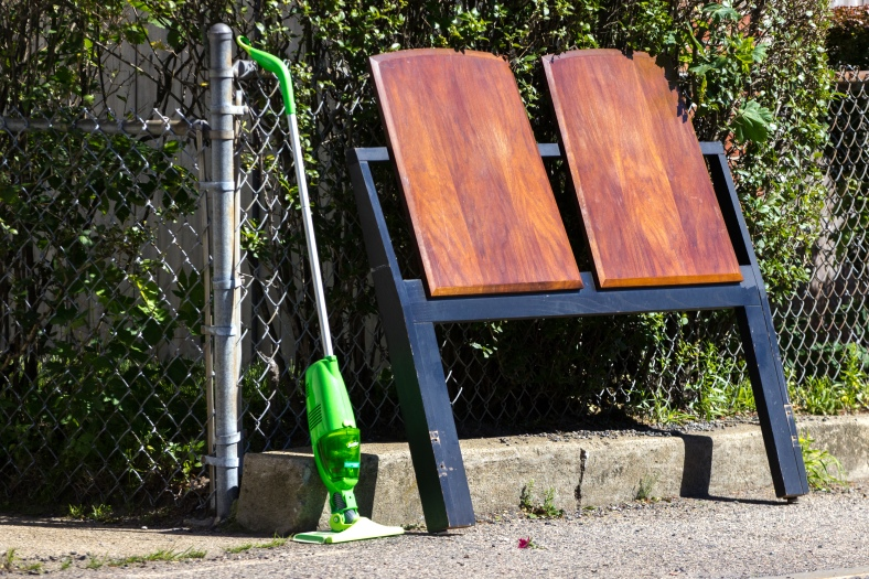 A headboard and mop, casualties of spring cleaning, on Mystic Street. June 20, 2014.